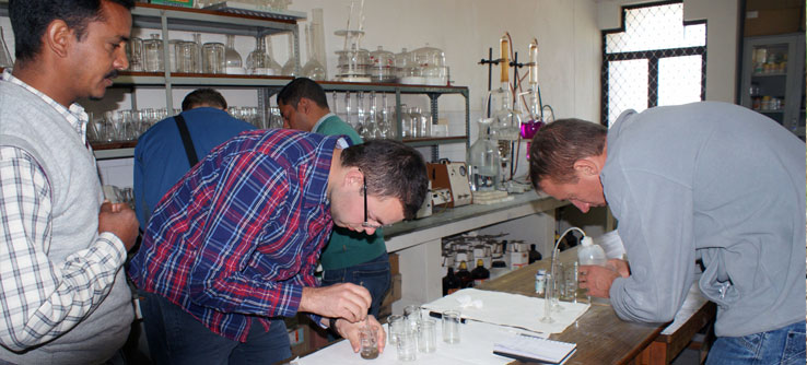 In the lab, volunteers analyze soil and vegetation samples.